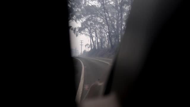stockvideo's en b-roll-footage met destruction in lithgow caused by bushfires shows: firefighters fighting bushfires, drone shot overlooking road showing smoke, view from car, remains... - sydney australië