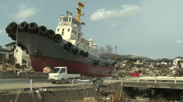 destruction in ofunato city, iwate, japan on 2nd april 2011; after tsunami following tohuku earthquake of march 2011.  the tsunami wave reached approx 23 metres high and continued inland for 3 kilometers.  stranded ship - emergencies and disasters stock videos & royalty-free footage