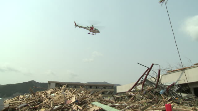 destruction in rikuzentakata, iwate prefecture, japan on 2nd april 2011; 3 weeks after the tsunami following the tohuku earthquake of march 2011. - tsunami stock videos and b-roll footage
