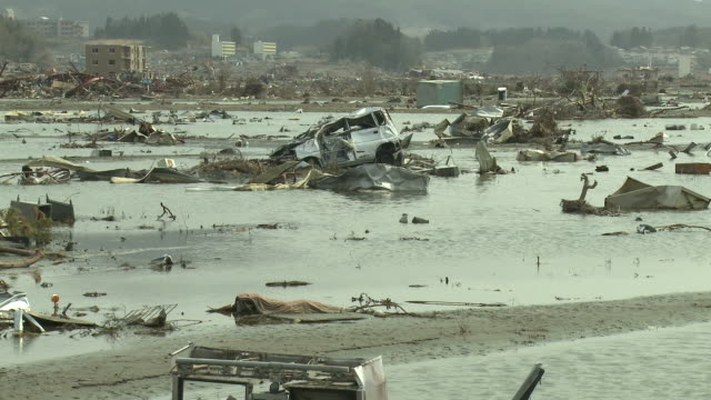 destruction in rikuzentakata, iwate prefecture, japan on 2nd april 2011; 3 weeks after the tsunami following the tohuku earthquake of march 2011. - tsunami stock videos & royalty-free footage