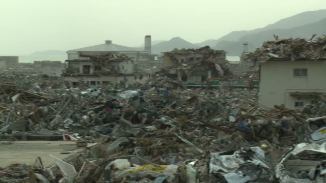 destruction in rikuzentakata, iwate prefecture, japan on 2nd april 2011; after tsunami following tohuku earthquake of march 2011.  this coastal town suffered severe damage with a large part of the residential area being completely flattened. - tsunami stock videos & royalty-free footage