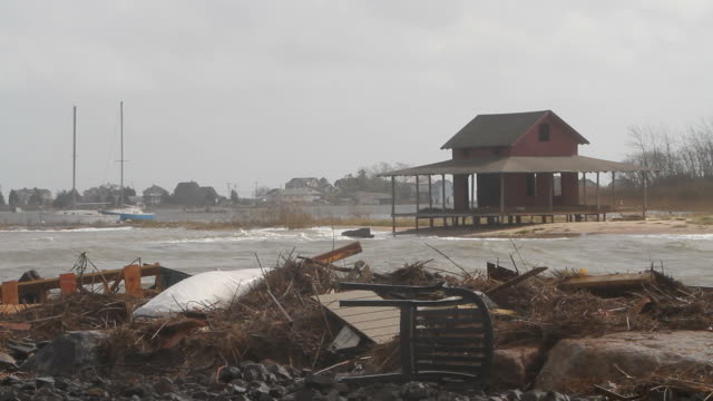destruction in the wake of hurricane sandy - environmental cleanup stock videos and b-roll footage