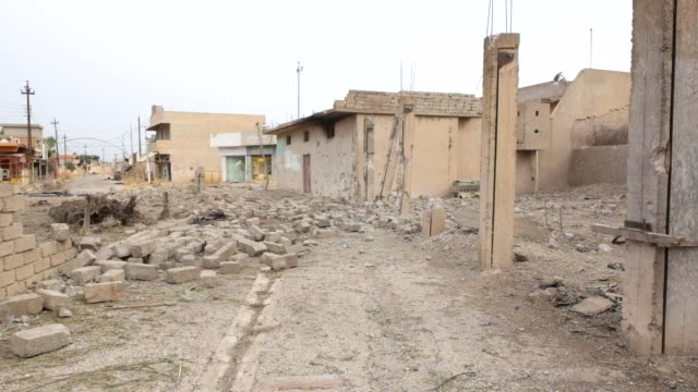 destruction on the streets of the assyrian village of karemlesh karemlesh village was liberated on october 27 2016 by iraqi and npu the situation in... - destruction stock videos & royalty-free footage