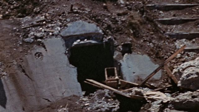 destruction outside japanese air raid shelter after the battle / saipan mariana islands - mariana islands stock videos and b-roll footage