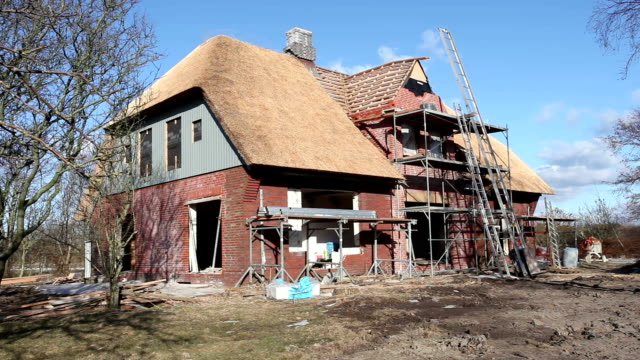detached house - construction site - thatched roof stock videos and b-roll footage
