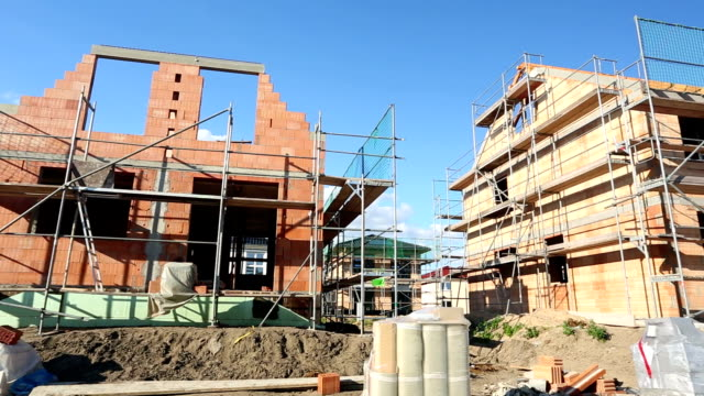detached house / construction site - scaffolding stock videos & royalty-free footage
