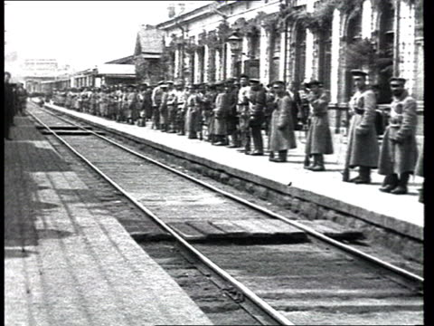 detachment of anarchists at a train station, soldiers on platform. - history stock videos & royalty-free footage