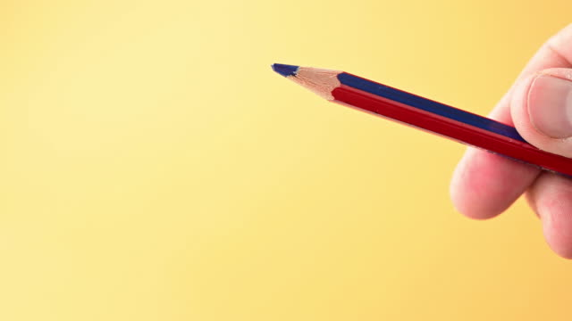 detail of a blue pencil that a man is holding in his hand. - pencil isolated stock videos & royalty-free footage