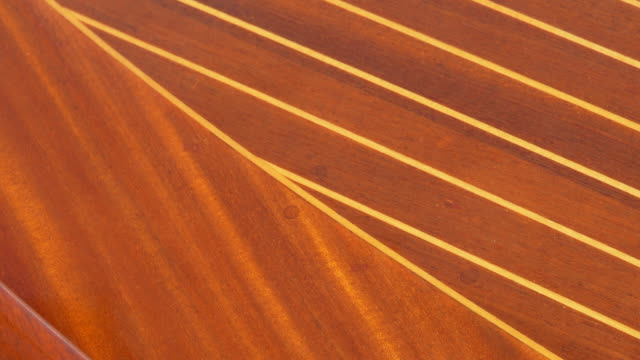 Detail of a classic luxury wooden runabout boat. - Slow Motion