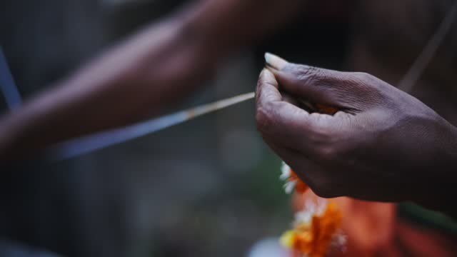 detail of a local's hand working on a traditional flowers decoration, fort kochi, india - tradition stock videos & royalty-free footage