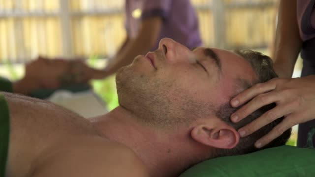 Detail of a man getting a massage at a resort spa.