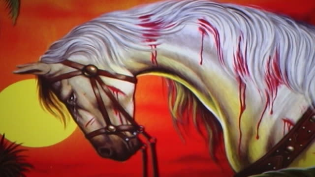 vídeos y material grabado en eventos de stock de detail of a painting depicting the horse of hussain ibn ali who was martyred at the battle of kerbala. this type of painting is used in the ashura... - ashura