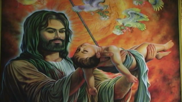 vídeos y material grabado en eventos de stock de detail of a painting of hussain ibn ali holding his dead child, who was killed during the battle of kerbala. this type of painting is used in the... - ashura