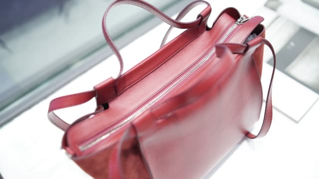 detail of a red handbag - borsetta video stock e b–roll
