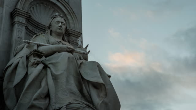 Detail of a statue of Queen Victoria on the Queen Victoria Memorial in front of Buckingham Palace