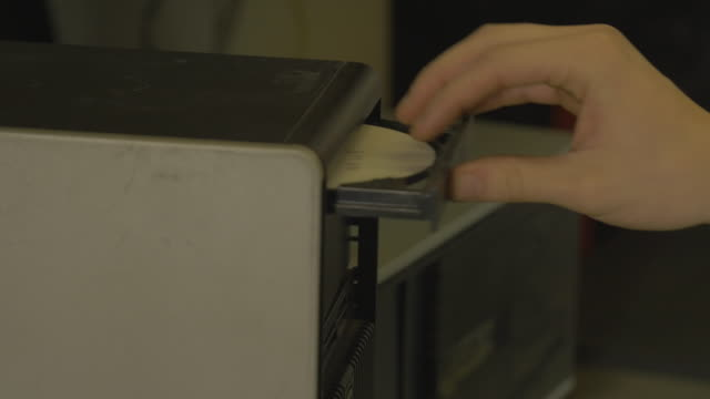 detail of a technician inserting a cd in a computer - compact disc stock videos & royalty-free footage