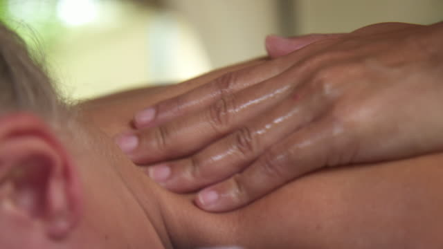 Detail of a woman getting a massage at a resort spa.
