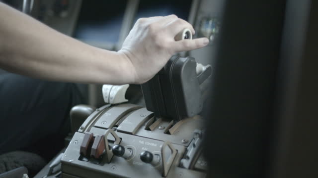 detail of airline pilot's hand on thrust lever - pilot stock videos & royalty-free footage