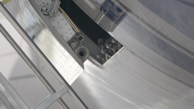 detail of airplane hatch closing - portello video stock e b–roll