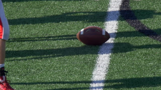 Detail of an American football. - Slow Motion
