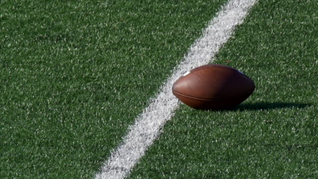 detail of an american football. - slow motion - football feld stock-videos und b-roll-filmmaterial