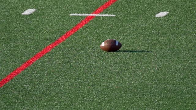 detail of an american football. - slow motion - sportschutzhelm stock-videos und b-roll-filmmaterial