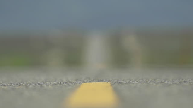 detail of an empty scenic desert road. - slow motion - tilt shift stock videos and b-roll footage