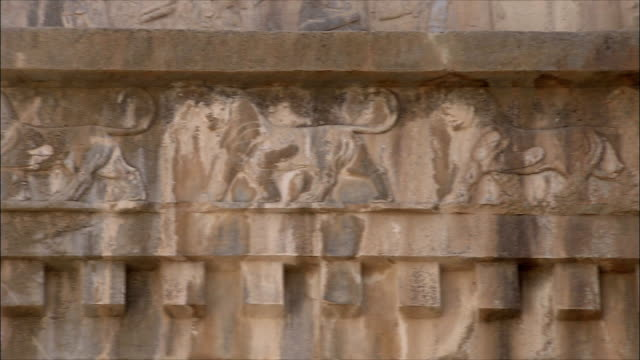 cu pan detail of ancient building with bas relief, persepolis, iran - bas relief stock videos & royalty-free footage