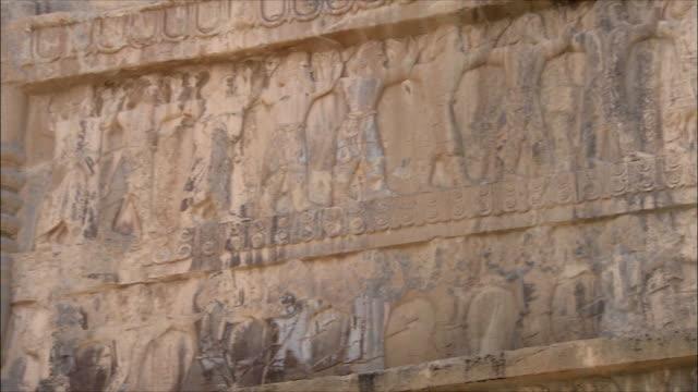 cu la pan detail of ancient building with bas relief, persepolis, iran - bas relief stock videos & royalty-free footage