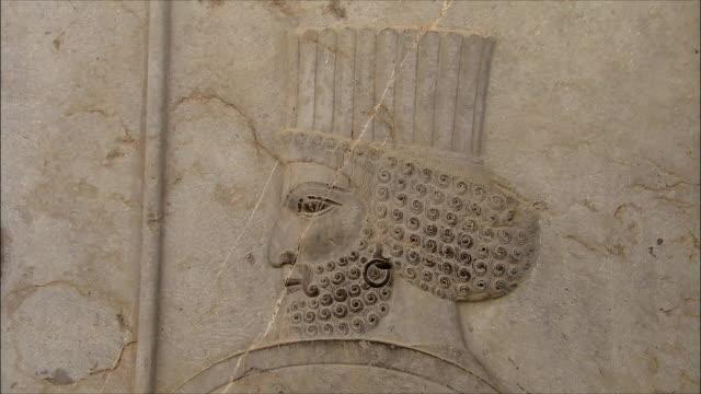 cu zi detail of bas relief depicting soldier, persepolis, iran - bas relief stock videos & royalty-free footage
