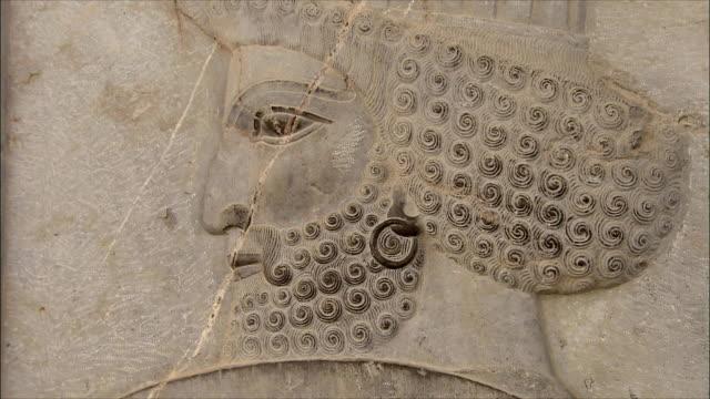 ecu zi detail of bas relief depicting soldier, persepolis, iran - bas relief stock videos & royalty-free footage