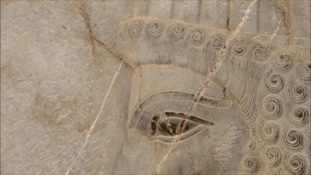 ecu td detail of bas relief depicting soldier, persepolis, iran - bas relief stock videos & royalty-free footage