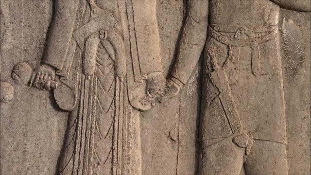 cu tu detail of bas relief, persepolis, iran - bas relief stock videos & royalty-free footage