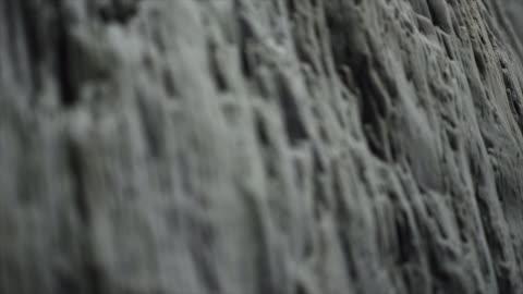 detail of basalt stack columns at reynisdrangar, iceland, europe. - mineral stock videos & royalty-free footage
