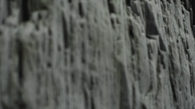 detail of basalt stack columns at reynisdrangar, iceland, europe. - rock formation stock videos & royalty-free footage