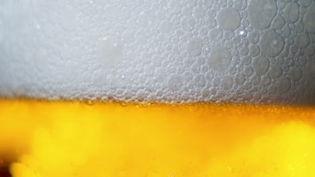 detail of beer filling glass - filling stock videos & royalty-free footage