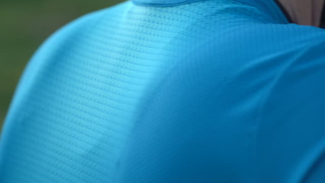 detail of bicycle jersey shirts, riding on road bikes in italy. - shirt stock videos & royalty-free footage