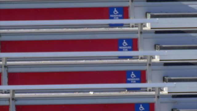 Detail of bleachers at a football stadium, handicap section. - Slow Motion