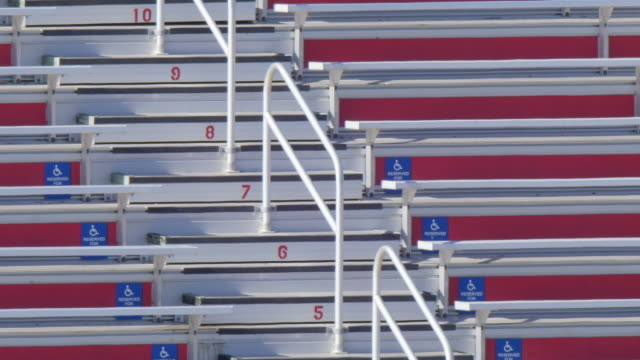 detail of bleachers benches handicap seats seating at a football stadium. - slow motion - stadium stock videos & royalty-free footage