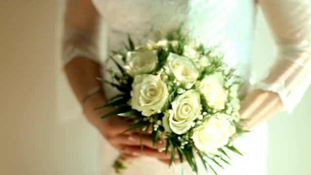 detail of bride holding bridal bouquet - wedding ceremony stock videos & royalty-free footage