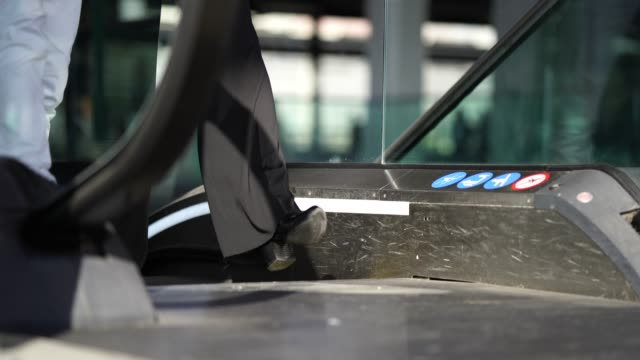 detail of business people feet reaching top of escalator - top garment stock videos & royalty-free footage