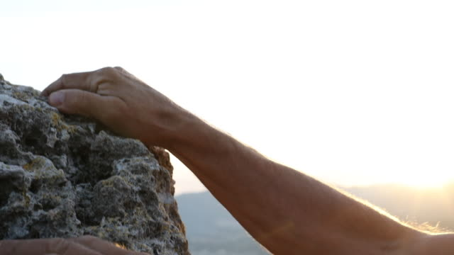 detail of climbers hands scaling vertical rock cliff - rock climbing stock videos & royalty-free footage