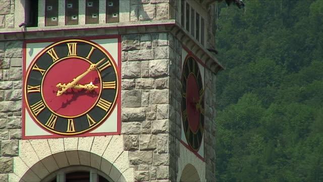 stockvideo's en b-roll-footage met cu detail of clock tower / near zurich, switzerland - klokkentoren met wijzerplaat