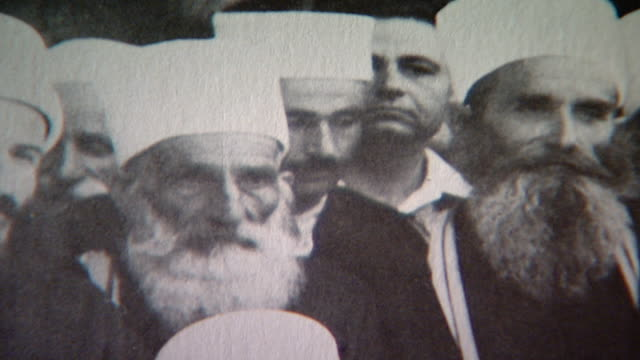 detail of druze sheikhs from a 1949 photo of kamal jumblatt in moukhtara with druze spiritual leader, sheikh el akl, sheikh mohammad abou chakra. - 1949 stock videos & royalty-free footage
