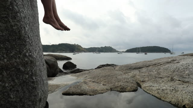 detail of feet dangling from granite boulder - granite rock stock videos and b-roll footage