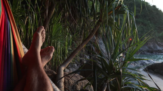 detail of feet relaxing in hammock - legs crossed at ankle stock videos and b-roll footage