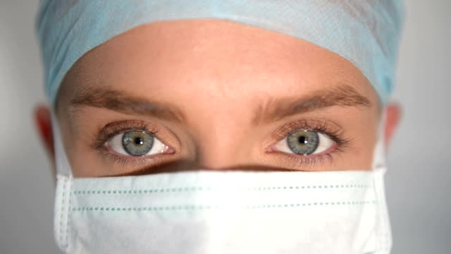 detail of female surgeon blue eyes - surgeon stock videos & royalty-free footage