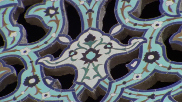 ECU detail of floral print on Sheikh Lotfollah Mosque window/ ZO CU arched window in blue mosque/ Isfahan, Iran