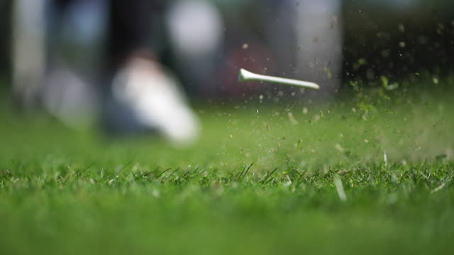 detail of golf tee on grassy terrain - golf course stock videos & royalty-free footage