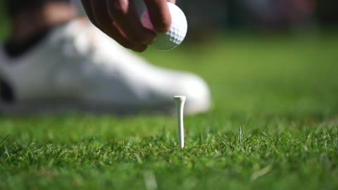 detail of golf tee on grassy terrain - putting stock videos & royalty-free footage